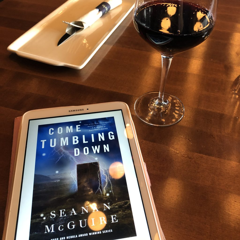 Come Tumbling Down by Seanan McGuire (book and wine)